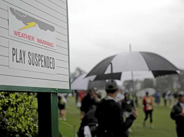 A sign showing play is suspended due to weather is seen during the par three competition at the Masters