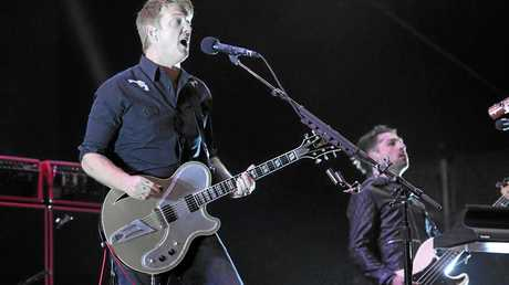 Josh Homme of Queens of the Stone Age. performs at the 2014 Coachella Music and Arts Festival on Saturday, April 12, 2014, in Indio, Calif. (Photo by Chris Pizzello/Invision/AP)