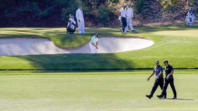 Jose Maria Olazabal (left) and Sergio Garcia walk up the 13th fairway at Augusta National.