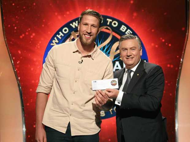 Will Sinclair accepts a cheque from Eddie McGuire for his win on Millionaire Hot Seat last night.