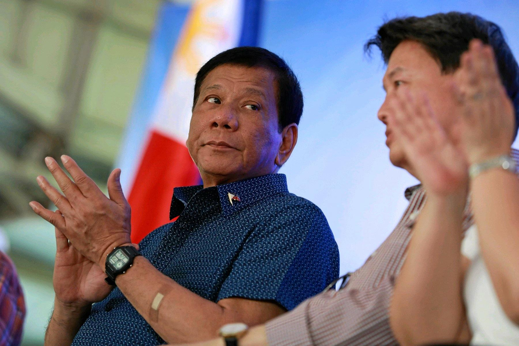 President Rodrigo Duterte, left, has defended adultery, creating controversy in the Philippines.