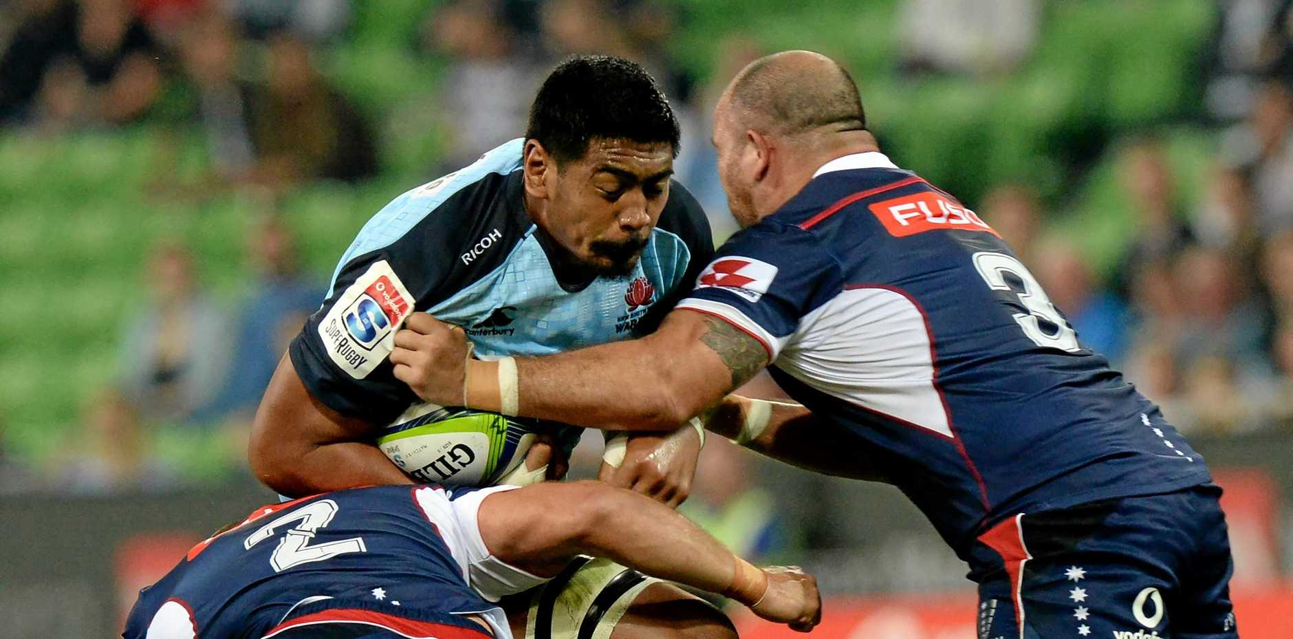 Waratahs Will Skelton (C) attempts to break a tackle from James Hanson (L) and Laurie Weeks (R) during the Round 5 Super Rugby match between the Melbourne Rebels and the NSW Waratahs at AAMI Park in Melbourne, Friday, March 24, 2017. (AAP Image/Mal Fairclough) NO ARCHIVING, EDITORIAL USE ONLY