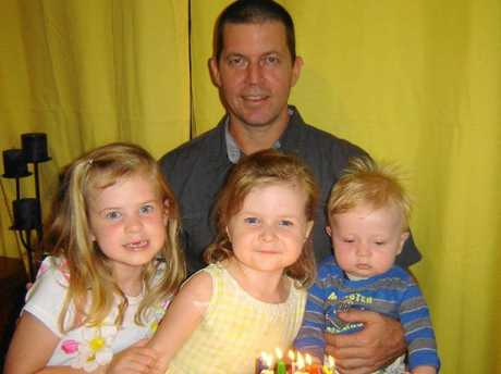 Father Matthew Kabealo with Ella-Jane, Chloe-May and Jacob.
