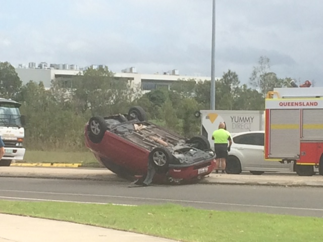 A car has flipped on Dalton Rd, outside the Maroochydore Bunnings.
