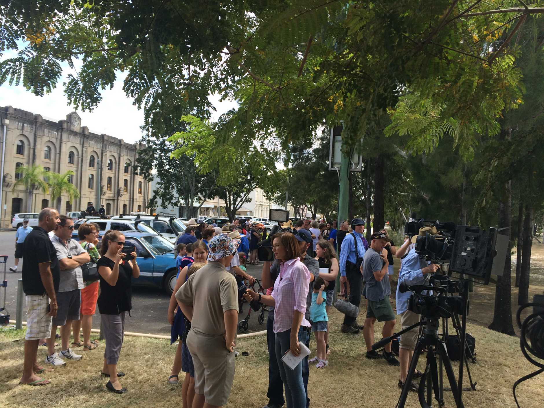 BIG CROWD: Residents are flocking to the banks of the Fitzroy to watch the peak.