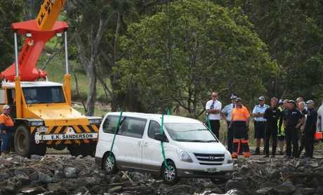 Mra King's van is removed from the Tweed River.