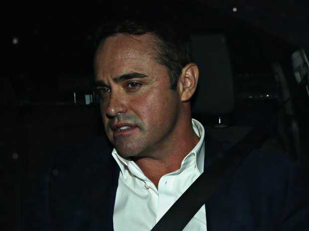 A Current Affair Journalist Ben McCormack leaving Redfern police station.