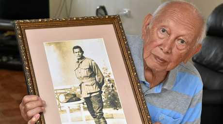 Keith Shang from Maryborough with a portrait of his father Sidney from WW1.