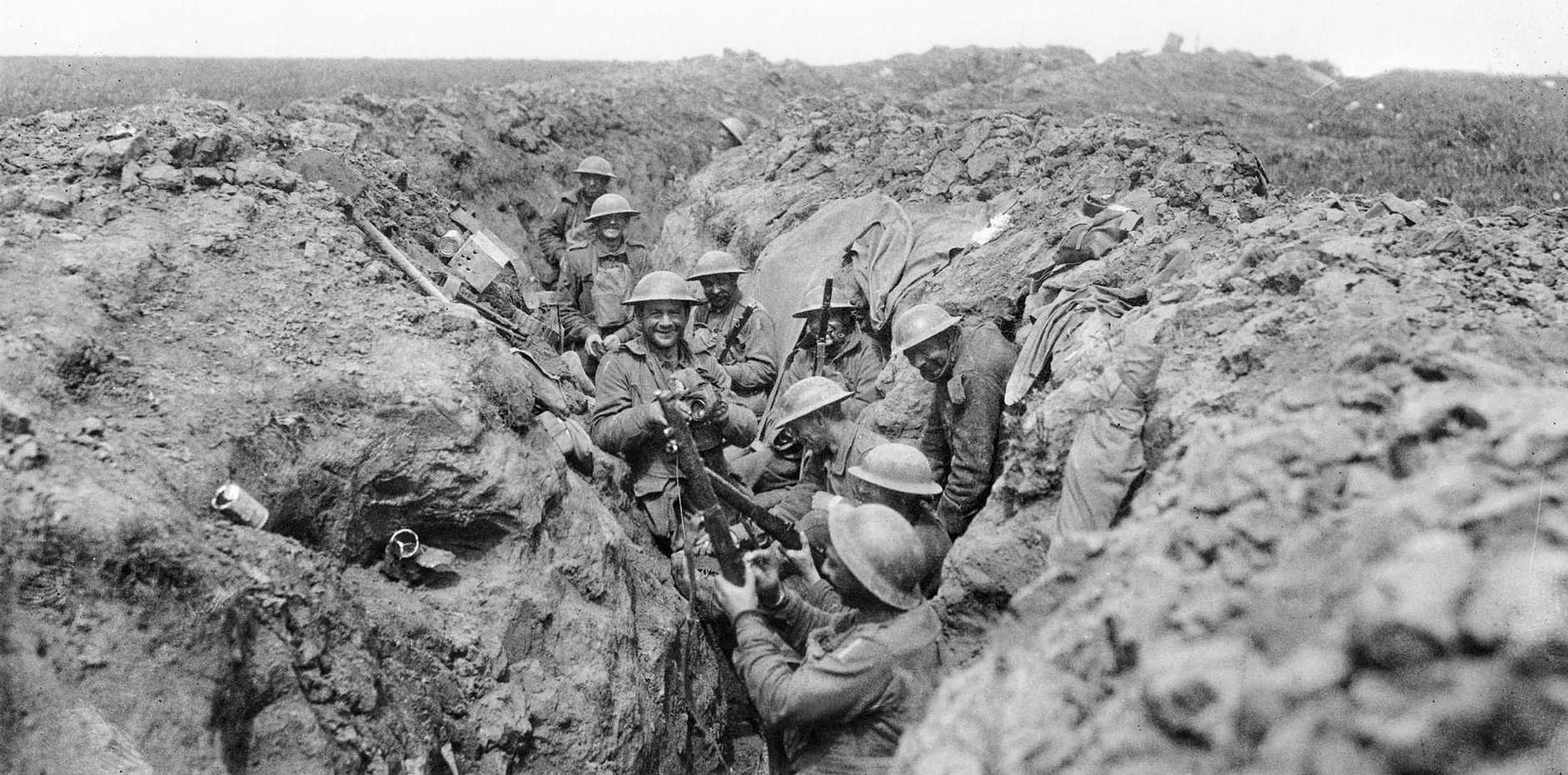 Australians clean their rifles in the second line of  trenches near Bullecourt.