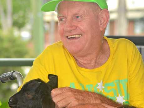 HEALING ANIMALS: John Shepherd makes friends with a young goat.