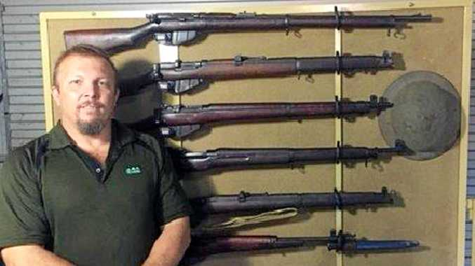 FIRED UP: Paul Fowkes with a section of his gun collection on display on Anzac Day 2015.