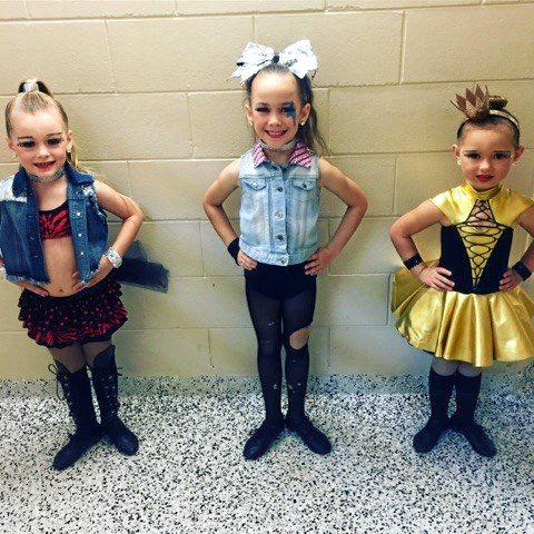 BACKSTAGE: Hannah Henderson, Brooke Smith and Makailei Bath pose in their costumes.