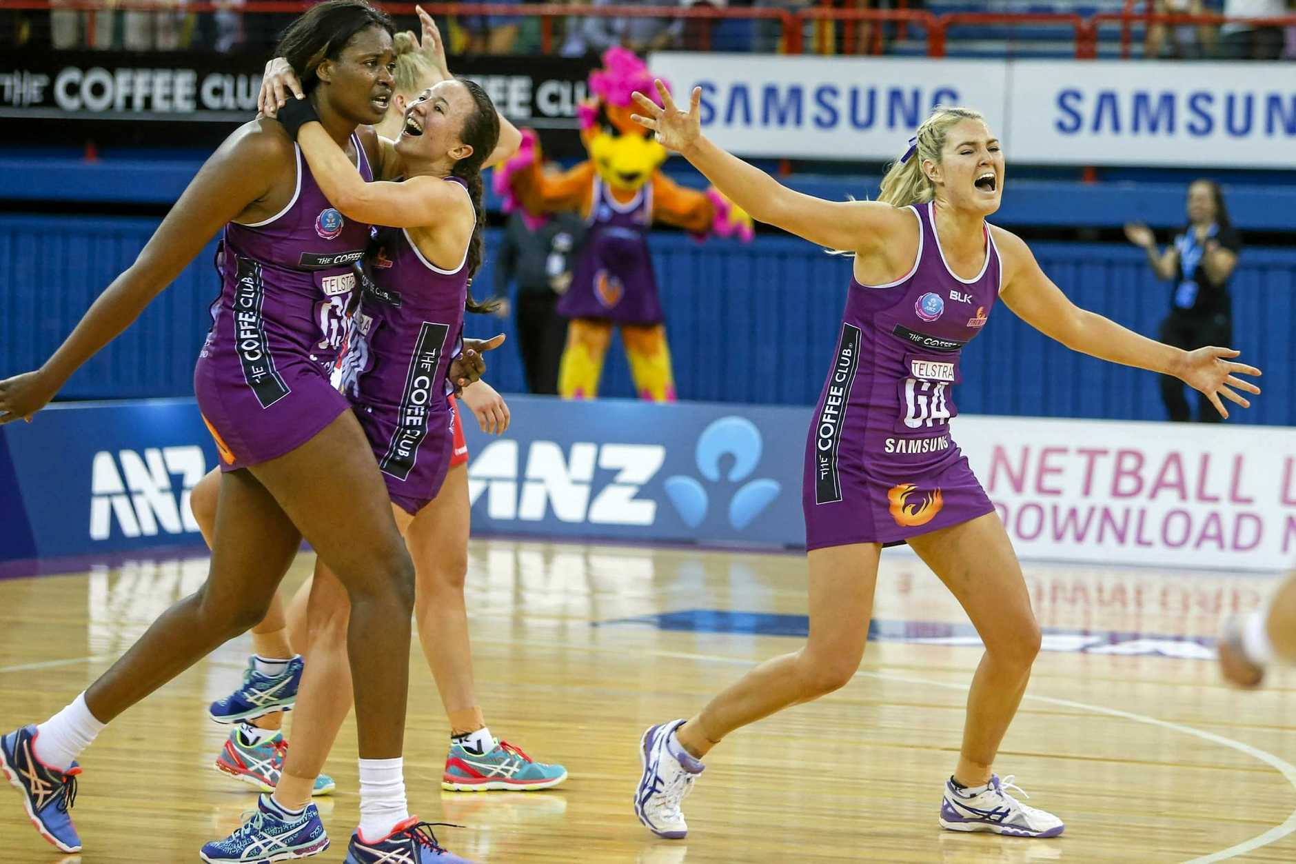 Romelda Aiken,Caitlyn Nevins and Gretel Tippett of the Firebirds celebrate after winning the grand final match of the ANZ Championship between the Queensland Firebirds and the NSW Swifts at the Brisbane Entertainment Centre in Brisbane, Sunday, July 31, 2016. (AAP Image/Glenn Hunt) NO ARCHIVING, EDITORIAL USE ONLY