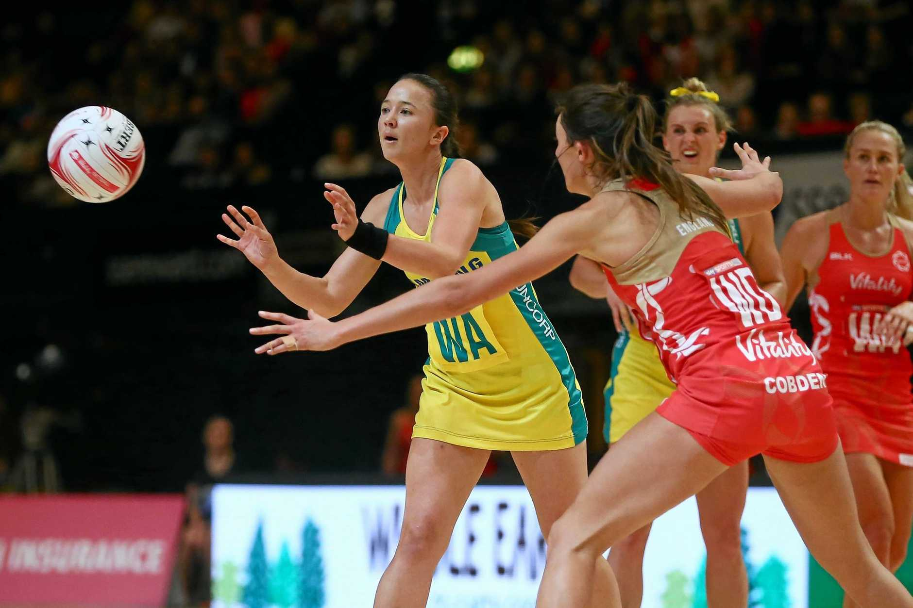 LONDON, ENGLAND - FEBRUARY 05:  Caitlyn Nevins of Australia passes past Beth Cobden of England during the Quad Series netball match between the England Roses and the Australia Diamonds at the SSE Arena on February 5, 2017 in London, England.  (Photo by Jordan Mansfield/Getty Images)