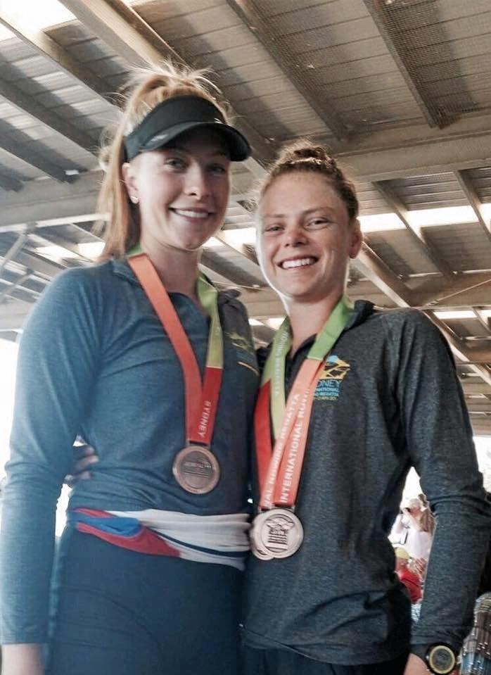 BRONZED: Crystal Piper and Gemma Dane with their medal haul at the National Rowing Championships.
