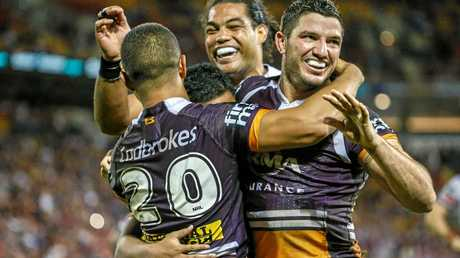 David Mead (left) of the Broncos celebrates with teammates after scoring a try.