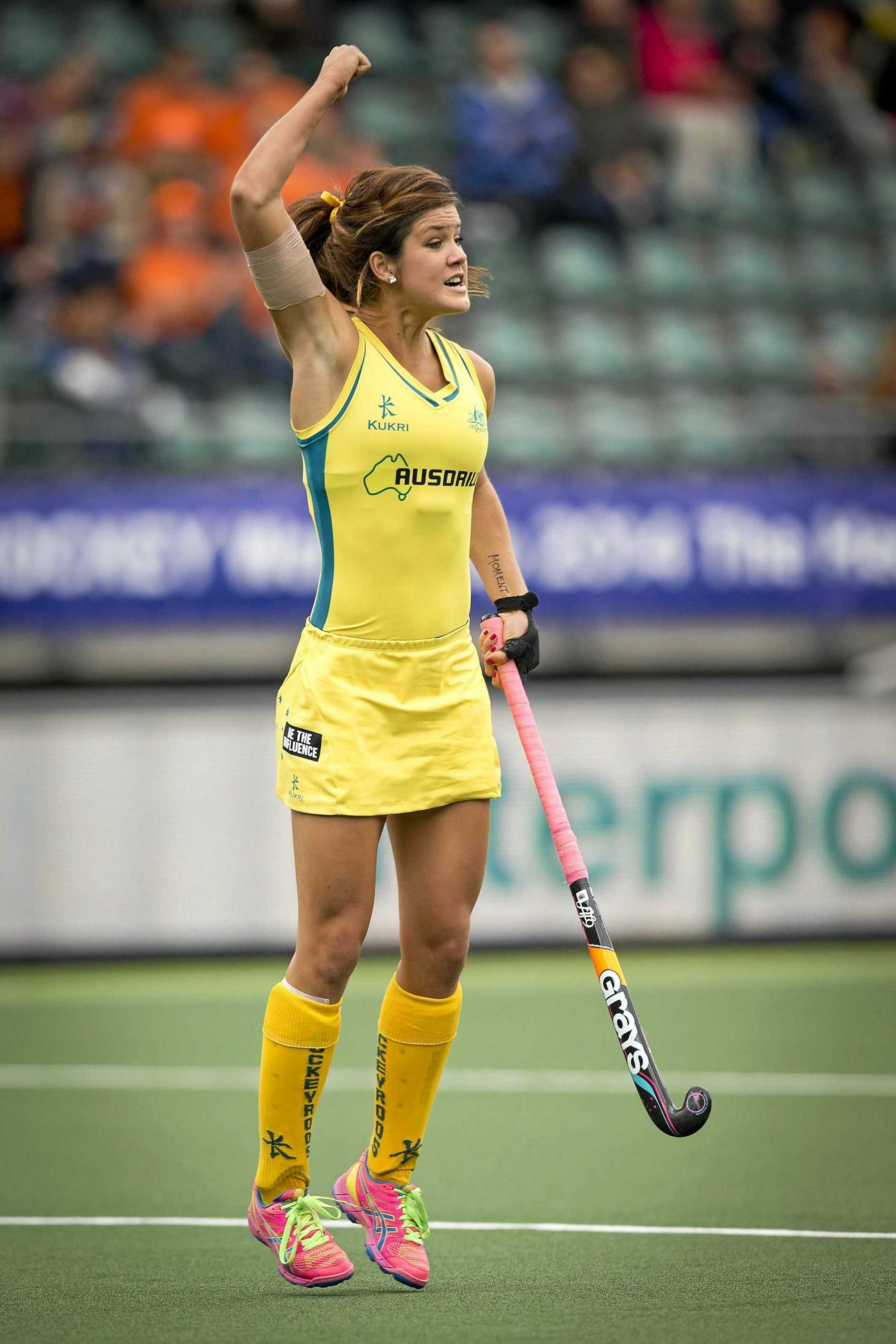 Anna Flanagan of Australia cheers after scoring against Belgium at the 2014 World Cup.