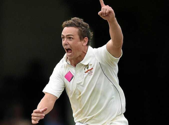 Australian Test spinner Stephen O'Keefe celebrates taking a wicket.