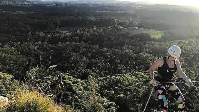 The Sunshine Coast hinterland provides a great backdrop for a sunset abseiling experience.