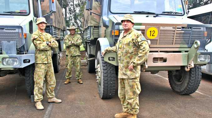 READY TO HELP: Army reserve personnel from the 41st Royal NSW Regiment, including Private Wouters, Major Piper and Private Johnson, are part of the military assistance ready to back up the SES during the Lismore flood emergency.