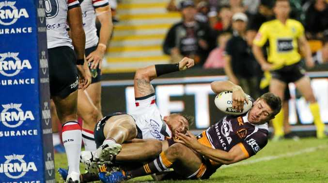 GREAT VISION: Andrew McCullough scores against the Roosters on Thursday night.