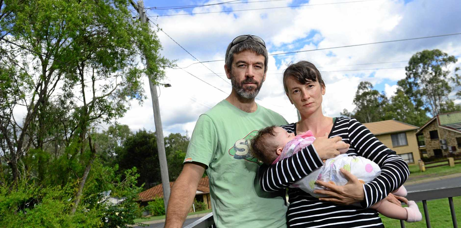 CUT OFF: Young parents Lillan and William Noble, with baby Hannah, are among hundreds of Brassall residents left without phone or internet services .