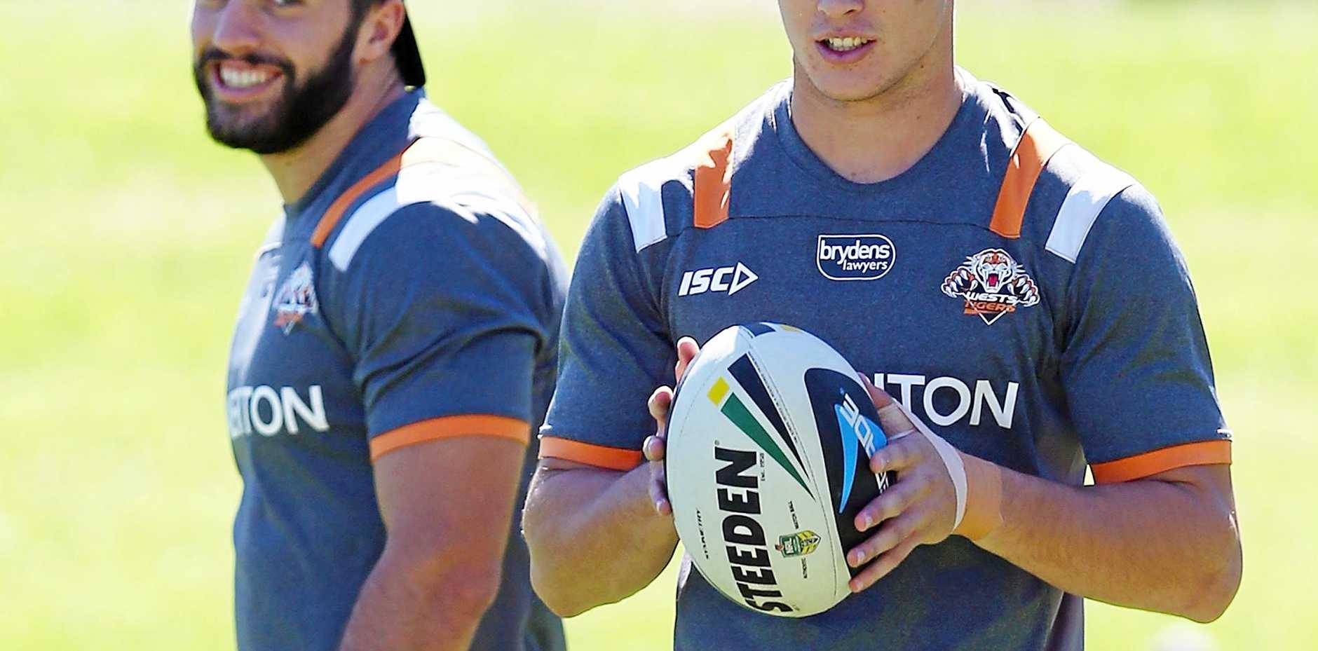 James Tedesco and Mitchell Moses at a Wests Tigers training session.