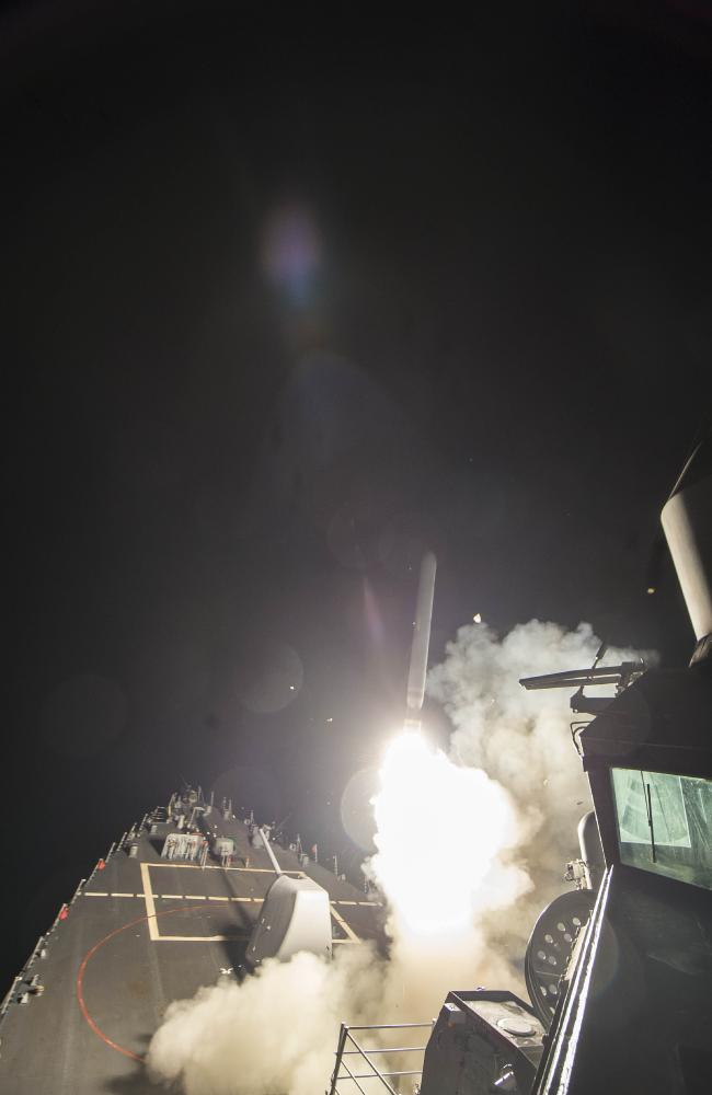 The USS Ross fires a tomahawk land attack missile against Syria.