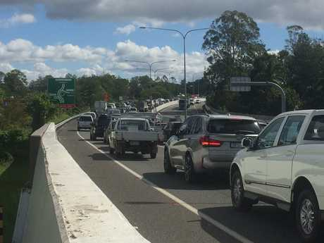 Traffic heading out of Kunda Park towards the highway after a crash on the Bruce Hwy interchange roundabout.