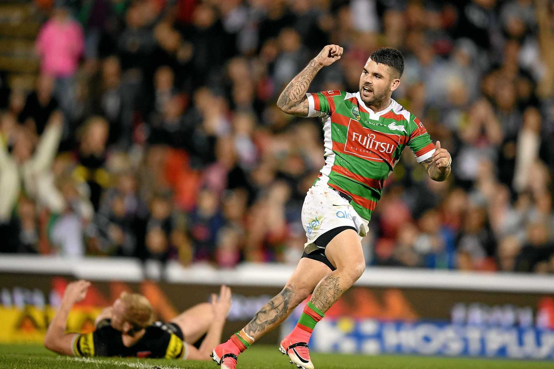 Adam Reynolds of the Rabbitohs reacts after kicking a field goal to win the game against the Panthers.