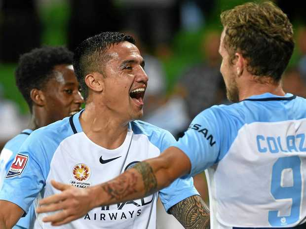 Melbourne City players react after Tim Cahill (centre) scored against Adelaide.