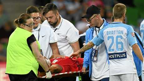 Tarek Elrich of Adelaide United is taken from the field by stretcher after sustaining an injury.