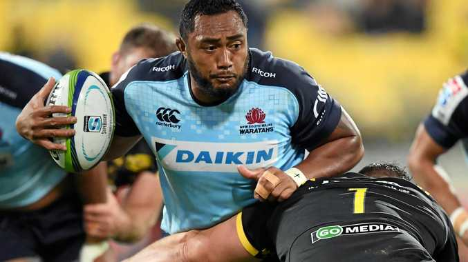 Sekope Kepu of the Waratahs is tackled by Ben May of the Hurricanes.