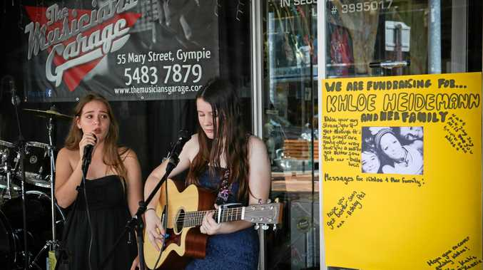 FROM THE HEART: Ashley Pel and Katie McKenzie busking outside of the Musician's Garage in Mary St.