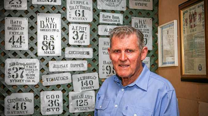 LOOKING BACK: Henry Bath along with the stencils used when shipping products across the country. Some stretch back to the beginning of the farm's history.