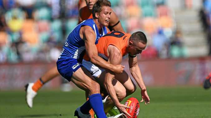 Andrew Swallow of the Kangaroos (left) and Tom Scully of the Giants.