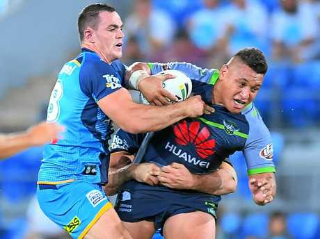 Josh Papalii of the Raiders takes on the Titans defence.