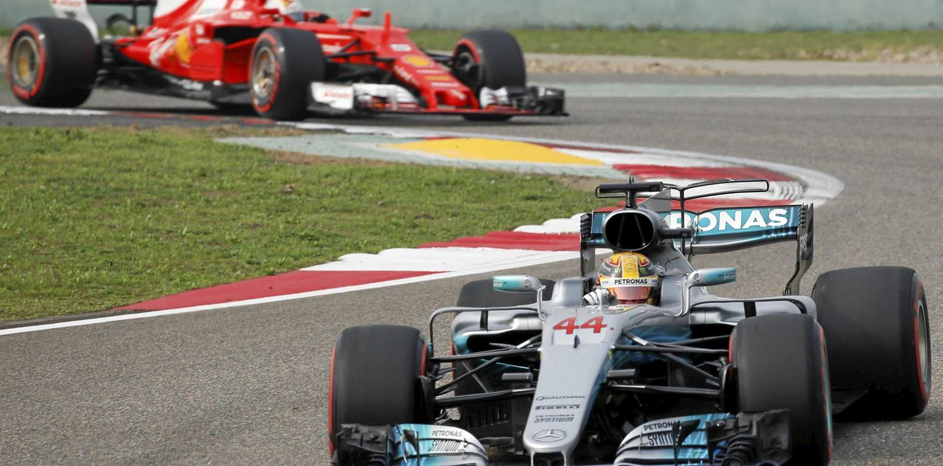 British Formula 1 driver Lewis Hamilton, of Mercedes, is followed by German driver Sebastian Vettel, of Ferrari, during qualifying for the Chinese Grand Prix in Shanghai.