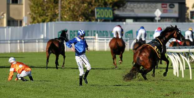 Almoonqith ridden by James Doyle (in blue) breaks a leg and Blake Shinn riding who shot Thebarman also fell in the Schweppes Sydney Cup.