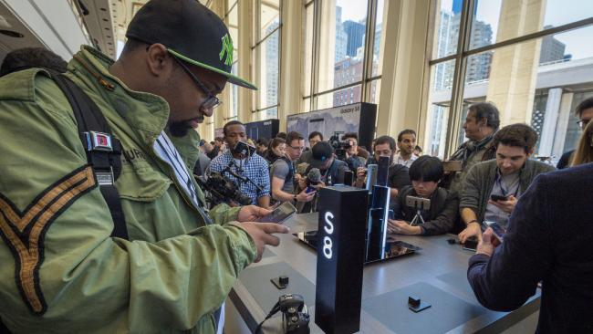 A man inspects the Samsung Galaxy S8 smartphone at its New York launch.