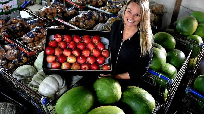 NO SHORTAGE: Rachel Erbacher of Erbacher's Fruit Shed says there are plenty of fruit and vegetables on offer despite the impact of Cyclone Debbie.