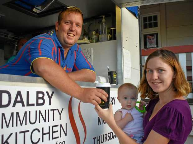 HELPING OUT: Dalby Soup Kitchen supervisor Dominic Smithson giving Sarah Richards and her daughter Isabella Ison some warm soup.