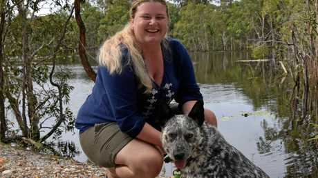 Yeppoon resident Sarah Tysoe and Marley at her dam in Tanby where a croc attacked her dog.