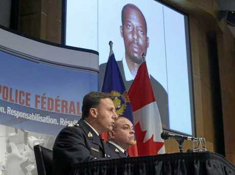 Royal Canadian Mounted Police assistant commissioner James Malizia, and Inspector Paul Mellon at a press conference about the arrest of Ali Omar Ader in 2015.