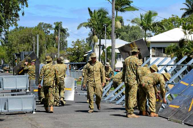 The Australian Defence Force takes apart a flood barrier on Rodboro St, Berserker.