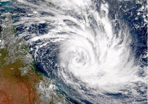 Cyclone Debbie as it moves across the Coral Sea over the North Queensland coast.