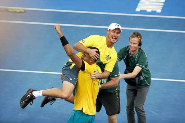 Nick Kyrgios celebrates with Australian coach Lleyton Hewitt.