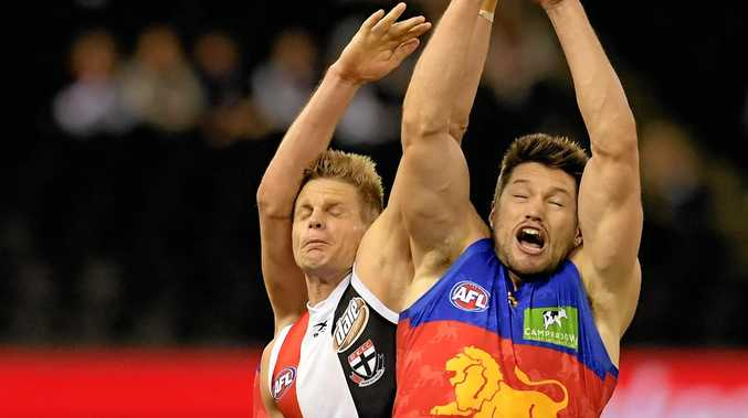 Nick Riewoldt of the Saints (left) and Stefan Martin of the Lions compete for the ball.