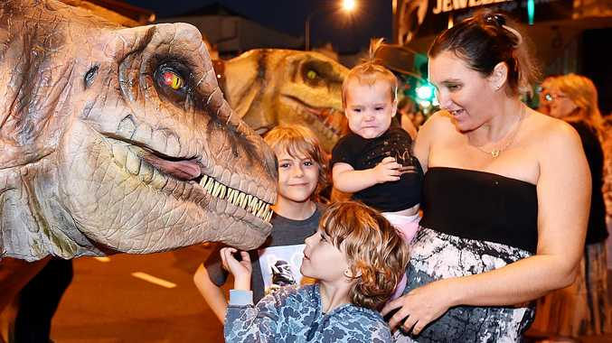 WOW: Christie Warry from Maryborough with Rivah-Lee, Blayze and Bailiey getting up close to the dinosaurs.