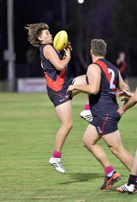 Aussie rules - Bombers V. Bay Power. Bombers player Nick Rourke takes a mark. Photo: Alistair Brightman / Fraser Coast Chronicle